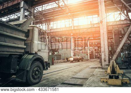 Big Cargo Freight Truck Inside Metallurgical Factory Workshop Interior Inside.