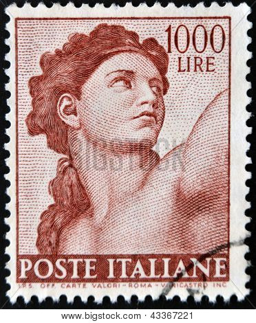 A stamp printed in Italy shows detailed figure of the Sistine Chapel painted by Michelangelo