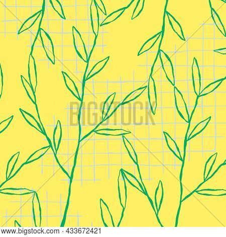 Green leaf pattern on yellow grid background