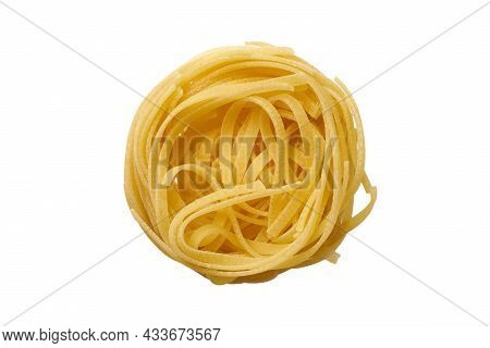Top View Of Raw Tagliatelle Pasta Isolated On White Background