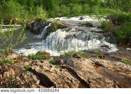 Rapids On The Suenga River. Stone Bank Of A Mountain River, Streams Of Water With White Foam, Green