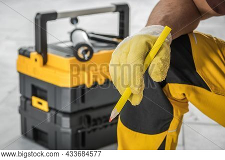 Caucasian Contractor Worker With Pencil In His Hand And Tools Box In A Background Industrial Project
