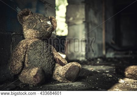 Domestic Violence Or Abuse Theme With Dirty Teddy Bear Inside House Ruins.