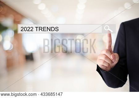 Businesman Hand Touching 2022 Trends Search Bar Over Blur Office Background, Banner, Seo 2022 Busine