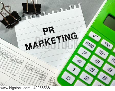 Business Concept.text Pr Marketing Writing On Notepaper With Calculator,paper Clips And Calculate Do