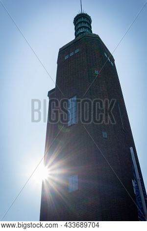 Rotterdam Holland - August 23 2017; Back-lit By Sun In Silhouette 1930s Brick & Glass Tower Of The M