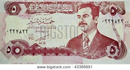 IRAQ - CIRCA 2000 : banknote 5 dinar Iraq showing the image of deposed leader Saddam Hussain