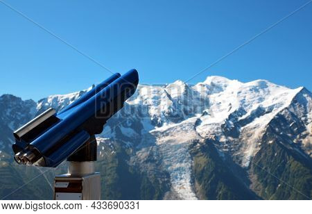 Telescope with Mont Blanc massif. View from the summit of Le Brevent. French Alps, Chamonix, France.