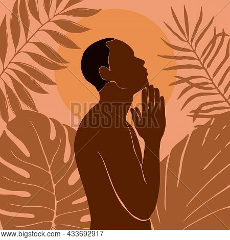 Afro American Man Stands In The Jungle. The Arms Are Folded Over The Chest. African Black Man Profil