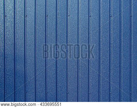 Background Of Blue Corrugated Metal Sheet. Modern Technologies In Construction. Metal Tiles. Reliabl