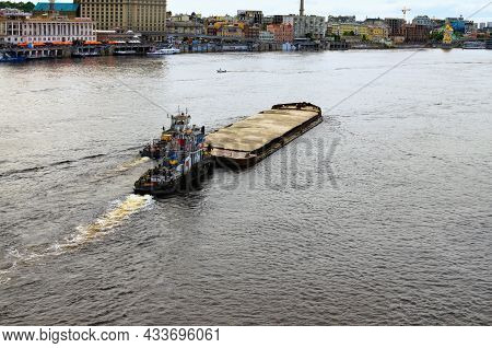 Kyiv, Ukraine-may 23, 2021:landscape View Of The River Barge Loaded With Sand And Two Tugboats. Emba