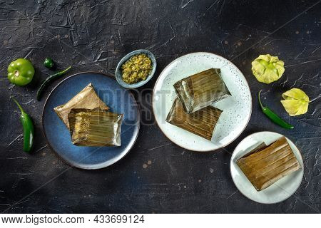 Tamal, Traditional Dish Of Mexican Cuisine, Various Stuffings Wrapped In Green Leaves. Hispanic Food