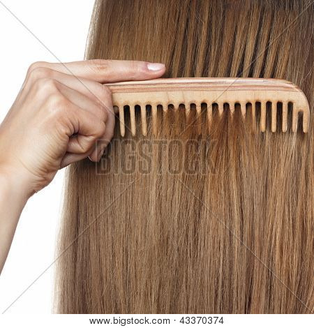 hair and comb. Space for text on hair background.