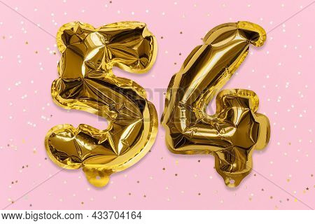 The Number Of The Balloon Made Of Golden Foil, The Number Fifty-four On A Pink Background With Sequi