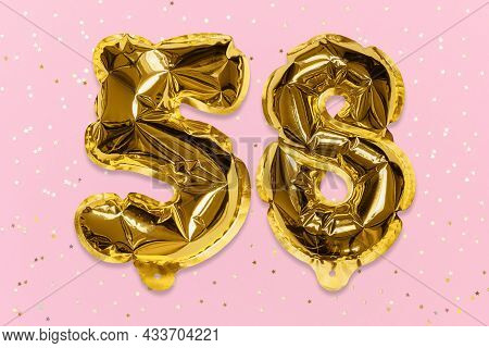 The Number Of The Balloon Made Of Golden Foil, The Number Fifty-eight On A Pink Background With Sequ