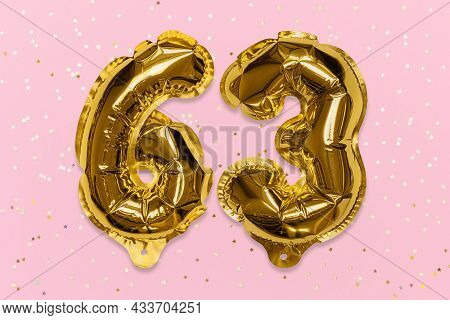 The Number Of The Balloon Made Of Golden Foil, The Number Sixty-three On A Pink Background With Sequ
