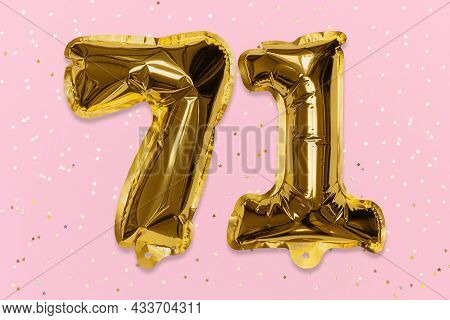The Number Of The Balloon Made Of Golden Foil, The Number Seventy-one On A Pink Background With Sequ