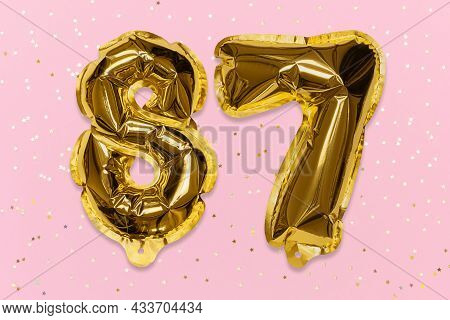 The Number Of The Balloon Made Of Golden Foil, The Number Eighty-seven On A Pink Background With Seq