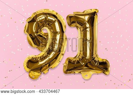 The Number Of The Balloon Made Of Golden Foil, The Number Ninety-one On A Pink Background With Sequi