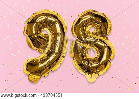 The Number Of The Balloon Made Of Golden Foil, The Number Ninety-eight On A Pink Background With Seq
