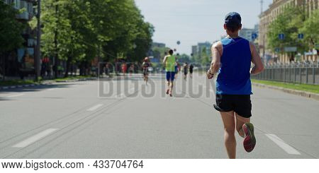 Wan In Sportswear Running Marathon In City