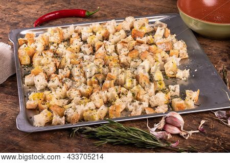 Croutons Preparation - Diced Ciabatta On A Baking Sheet With Olive Oil, Rosemary And Garlic