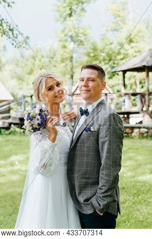 Portrait Of Happy Young Married Couple, Smiling Newlyweds Posing Together Outdoors, Bride And Groom