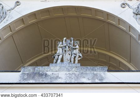 Statue Of A Group Of Cupids With The Lyre Of Apollo In The Temple Of Apollo. The Temple Of Apollo In