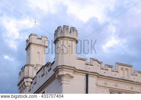 The Towers Of Lednice Castle With Sky And Clouds. The Castle Was Inscribed On The Unesco List In 199