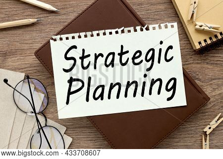 Business Strategic Planning. Notepad Page On Notepad On Wood Table. With Place For Text. Near Office