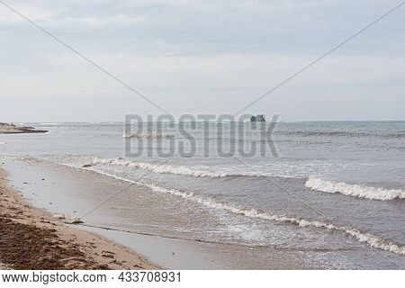 Storm Sea Sand Beach Is A Neutral Color. Natural Background In Beige Shades. The Raging Elements, Th