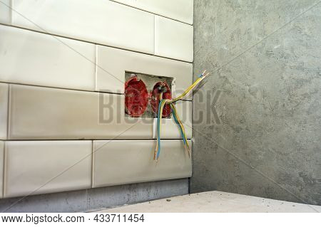 An Open Socket With Live Wires Mounted On A Wall, Shallow Dof