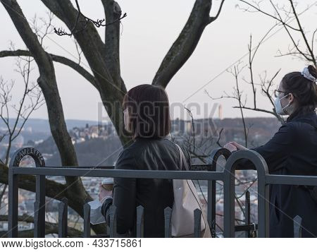 Prague, Czech Republic, March 26, 2021: Two Young Women Tourist In Face Mask At View Point On Petrin