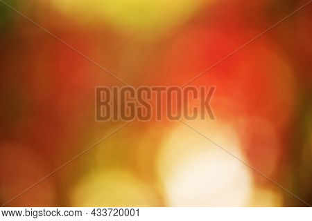 Defocused Beautiful Bokeh With Autumnal Red And Yellow Leaves. Defocus Light Autumn Background.
