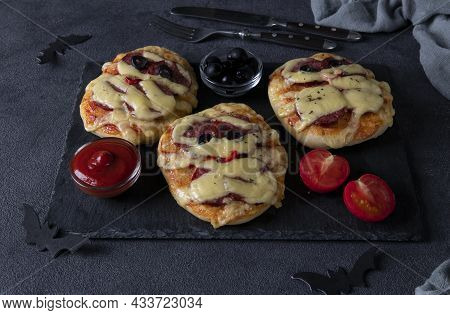 Funny Mini Pizzas Mummies With Sausage And Cheese For Halloween Party, Served With Black Olives, Ket