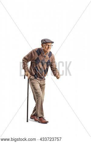 Senior man with a walking cane walking slowly isolated on white background