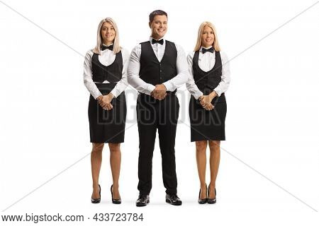 Team of waiters in uniforms posing isolated on white background