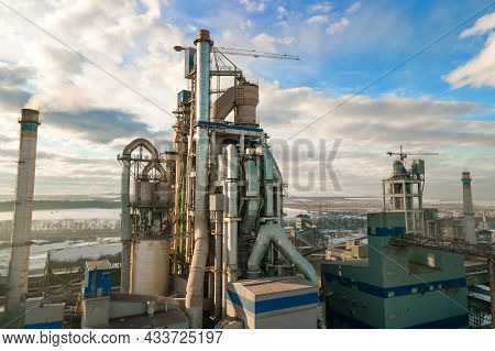 Aerial View Of Cement Plant With High Factory Structure And Tower Crane At Industrial Production Are