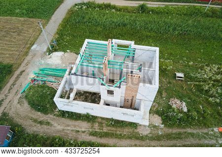 Aerial View Of Unfinished Frame Of Private House With Aerated Lightweight Concrete Walls And Wooden
