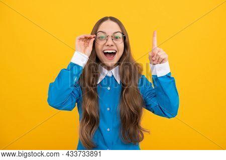 Genius Idea. Girl Genius With Raised Finger. Child Prodigy In Eyeglasses. Wunderkind. School Educati