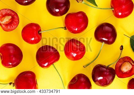 Cherry Background. Fresh Cherries On A Yellow Background. Top View
