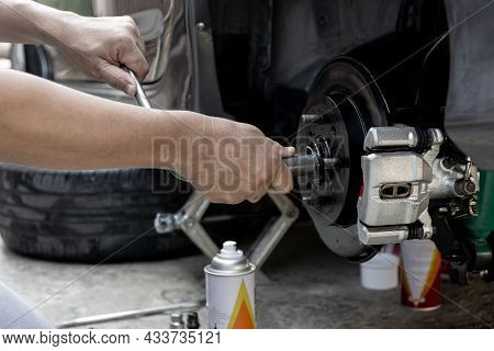 A Man Repairing And Simple Test Bolt Of Car Wheel After Repair Paint And  Maintenance That Can Be Ma