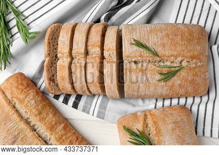 Delicious Ciabattas With Rosemary On Beige Wooden Table, Flat Lay