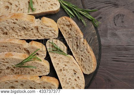 Delicious Ciabatta With Rosemary On Wooden Table, Top View