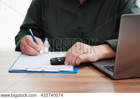 Car Insurance Staff Writing On The White Paper Clip File Board Hold Car Key And Memo Insurance Data