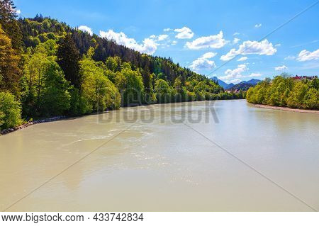 Flowing Lech River In Bavaria Germany . Coniferous Forest Growing On The Riverside In Bavaria