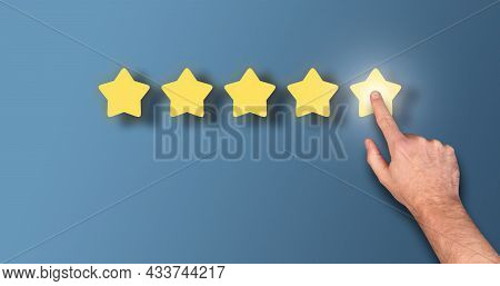 Feedback Concept, Customer Giving 5 Star Rating Against Blue Background With Copy Space
