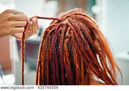 Stylish Therapy Professional Care Concept. Close Up Of Braiding Process Plait With Colored Kanekalon