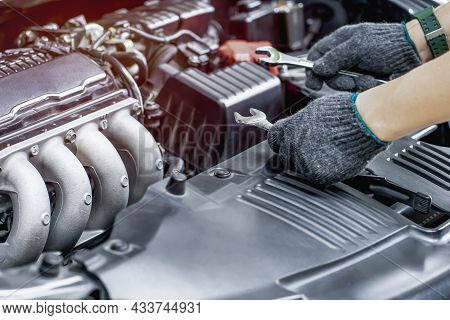 Technician Is Using A Wrench For Repair Car In Car Service And Maintenance Concept