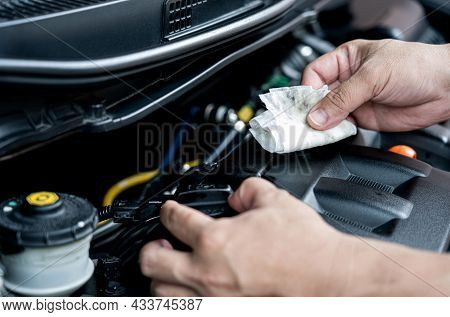 Home Service Car Concept : A Man Use Cloth Cleaning Engine Oil Stain And Open The Oil Cap Of Engine